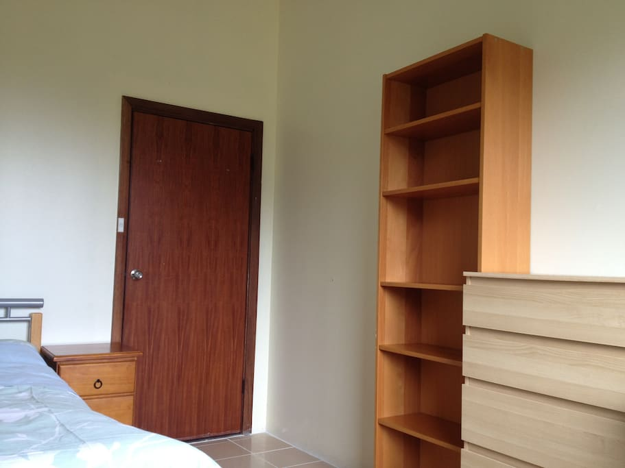 The room has book case & IKEA chest of drawers