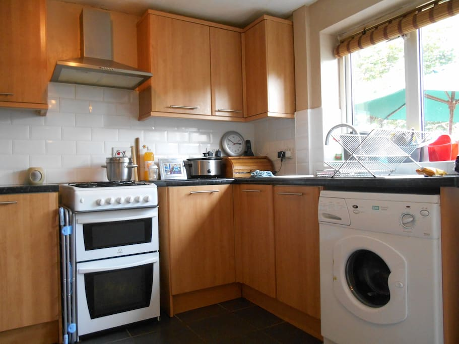 modern kitchen with washing machine and microwave facilities