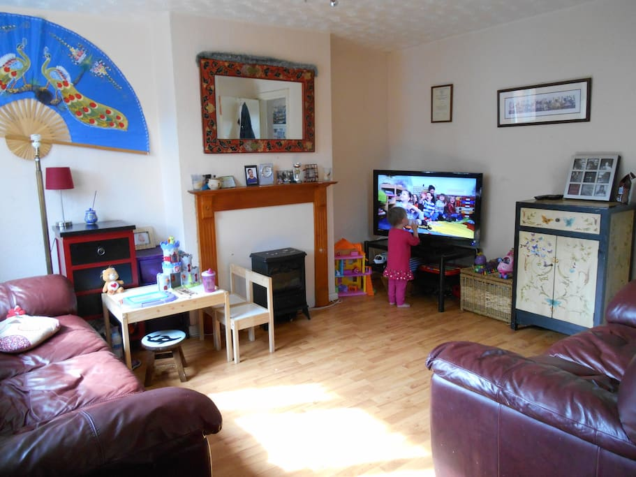 living room with leather sofa and free view TV, DVD player, games, daughter in background (nearly 2)