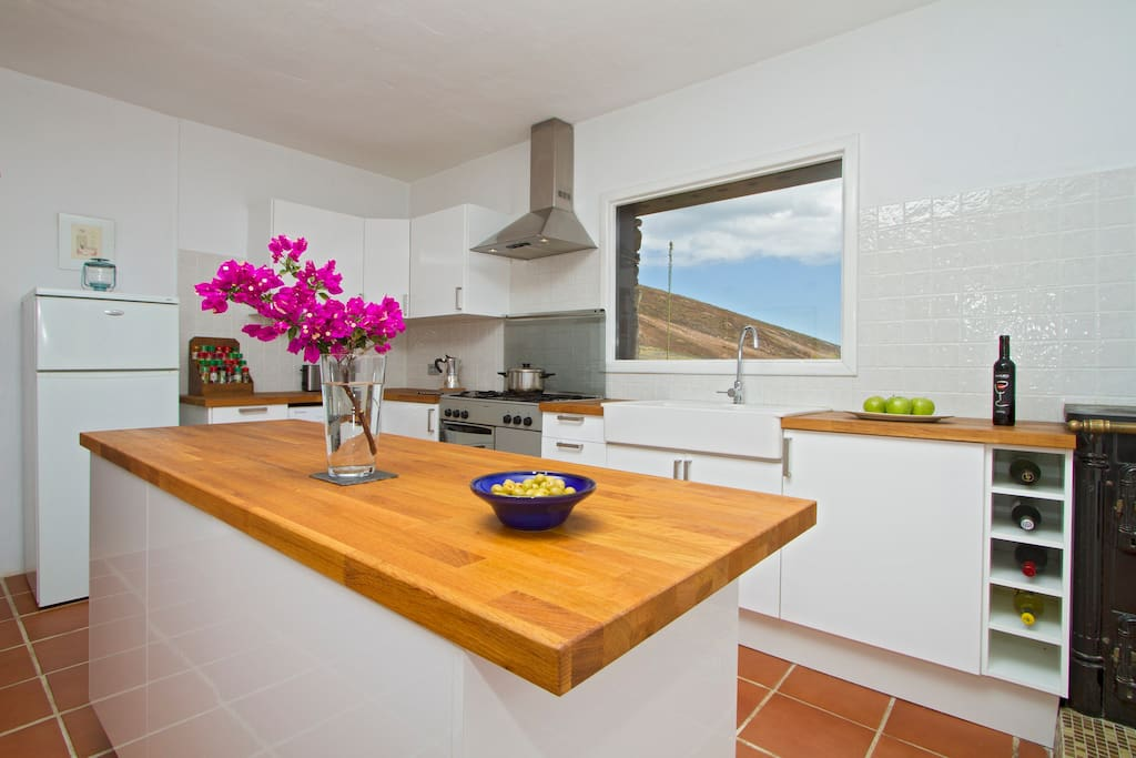 Spacious kitchen diner with views of garden and sea