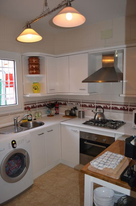 Fully fitted kitchen with oven, hobb, extractor, american fridge, coffee machine, microwave, washing machine, toaster etc