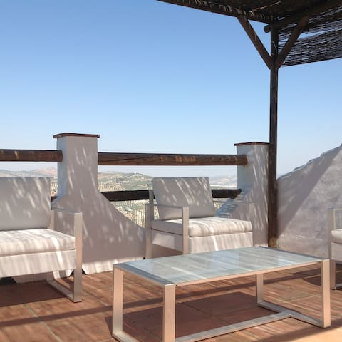 Modern comfortable settees and chairs to enjoy a drink and take in the stunning views