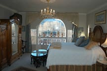 King bed, armiore and picture window.