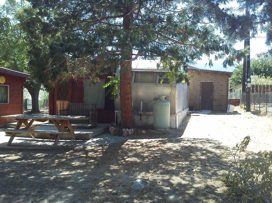 3 units, rustic cabin, airstream trailer, bathroom w/ laundry room