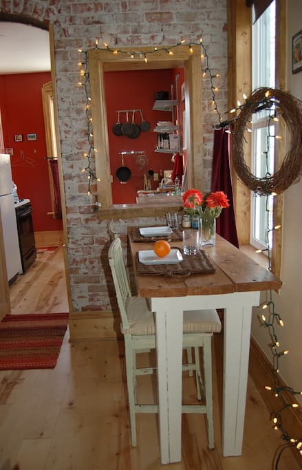 The dining space has charming exposed brick and candle-lights for a special meal.