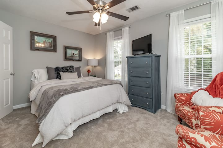 Bedroom 2 with TV and queen bed