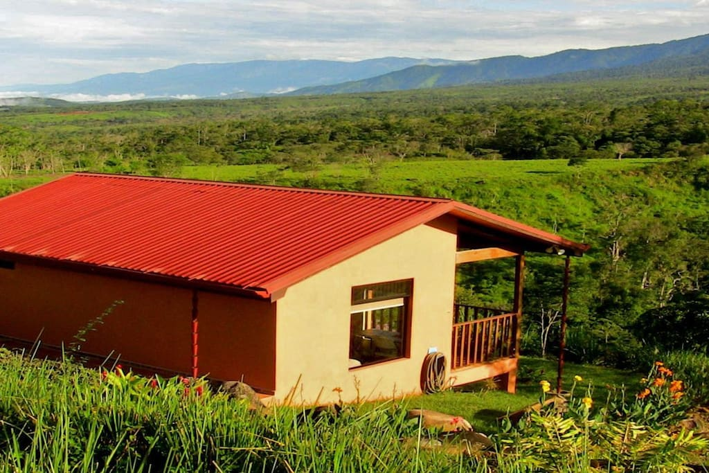 The Talamanca views are spectacular, the views show the river, mountains and pasture lands below. This is the sunrise cabin and sunsets are visible too!
