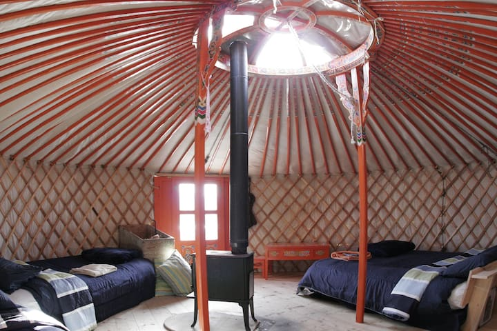 Comfortably sleeping 4 adults the Yurt is kept warm in the chilly months by the wood burning stove. Perfect for keeping you cozy on those wintery nights.