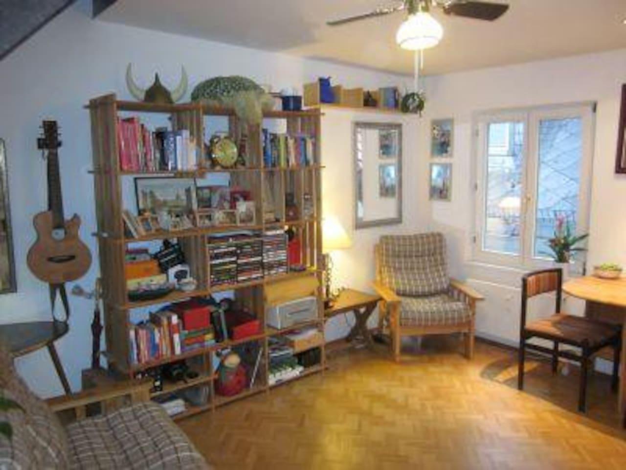 Lower floor, with kitchen, shower/bathroom, sofas, TV.