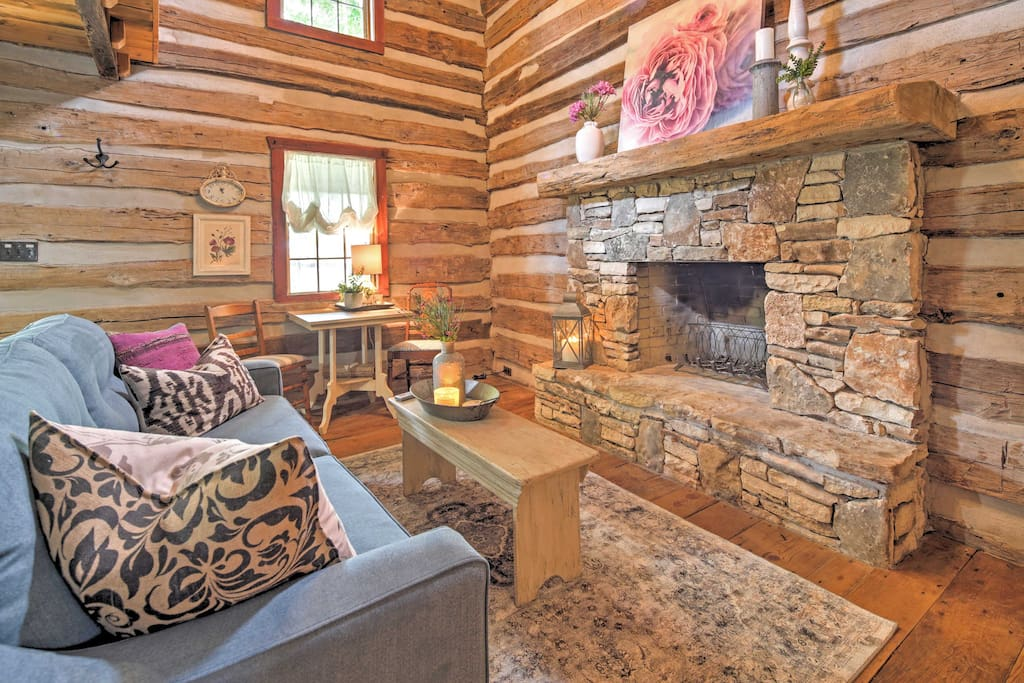 Through the front door of this completely remodeled wooden cabin, you are surrounded by elegant cottage decor and rich comforts.