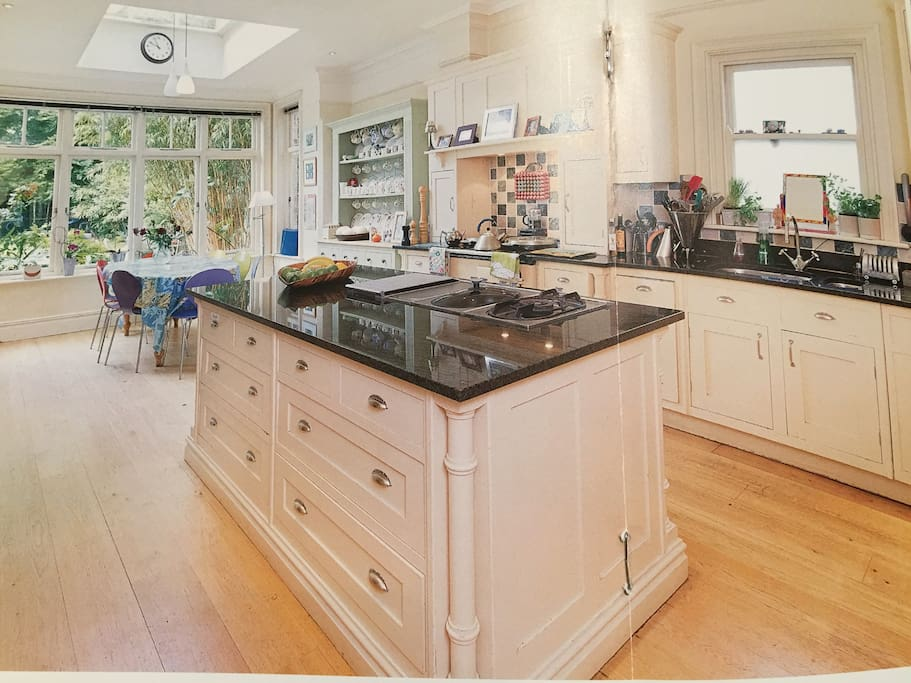 Large kitchen, looking on to garden with Aga and Gaggenau modern cooking facilities, well stocked cooking utilities, kitchen table to seat 8 easily.
