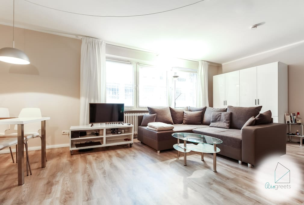 Relax on the large sofa and watch a good movie on TV.