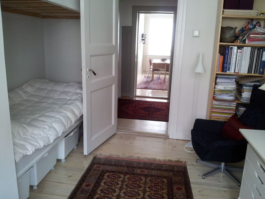 Comfortable room with good lighting, warm duvet, clean sheets, reading area and writing table.