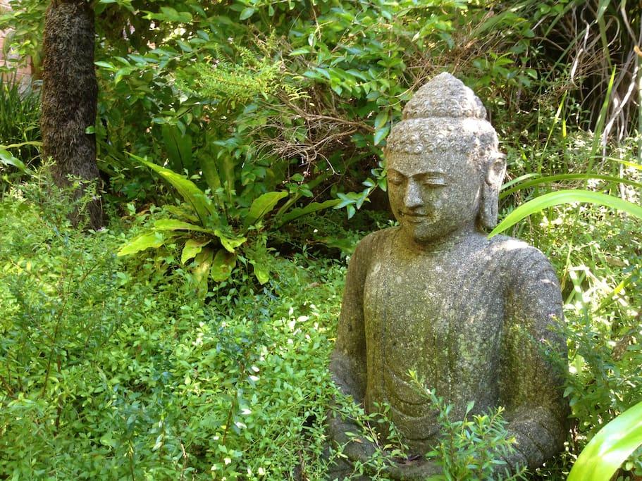 stone buddha in the garden