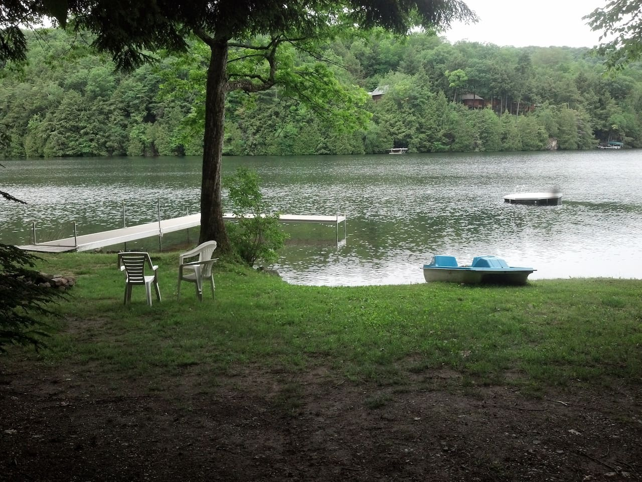The dock on Dunmore Lake with paddle boat and canoes!