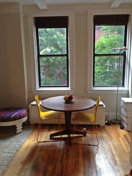 Window seat & large windows offer lots of light and street view