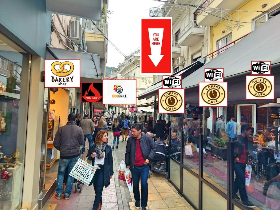 Buildings Main Entrance surrounded from 3 cafe's in a row with Free Wifi ,Bakery ,BBQ shops ,Gyros - Grill bars and more.  - Κεντρική Εισοδος που περιβάλλεται απο 3εις Καφετέριες ,Φούρνο ,Snack bars & άλλα.