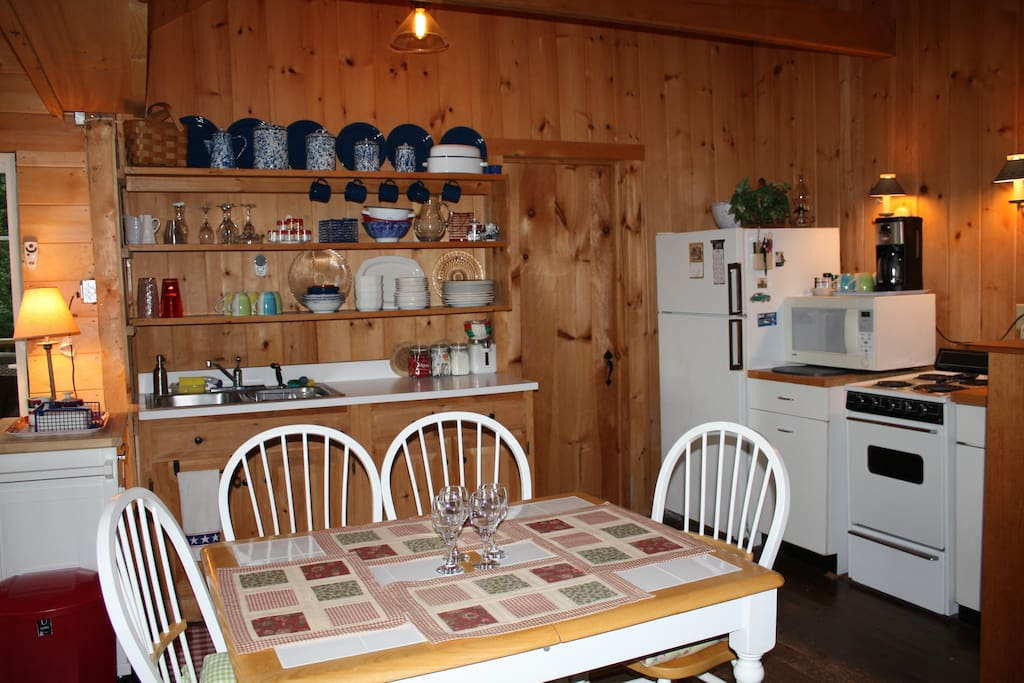 Fully equipped kitchen featuring an eat-in area with enough room for eight!