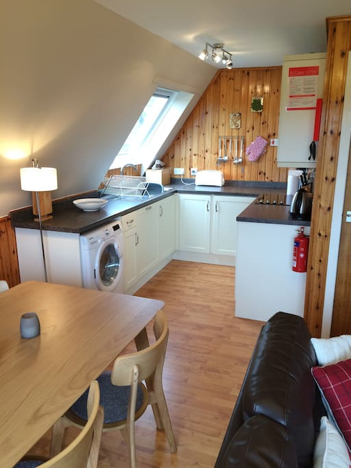 Fully equiped kithchen with washer/dryer, dishwasher fridge, oven, hob and microwave.