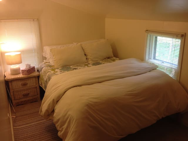 Main, small bedroom, Queen size. First floor, but feels like an attic, small room where you can snuggle and pretend there is no winter.