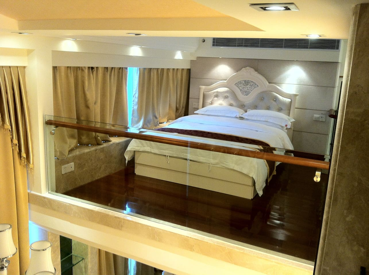 Queen size bed on the second floor.