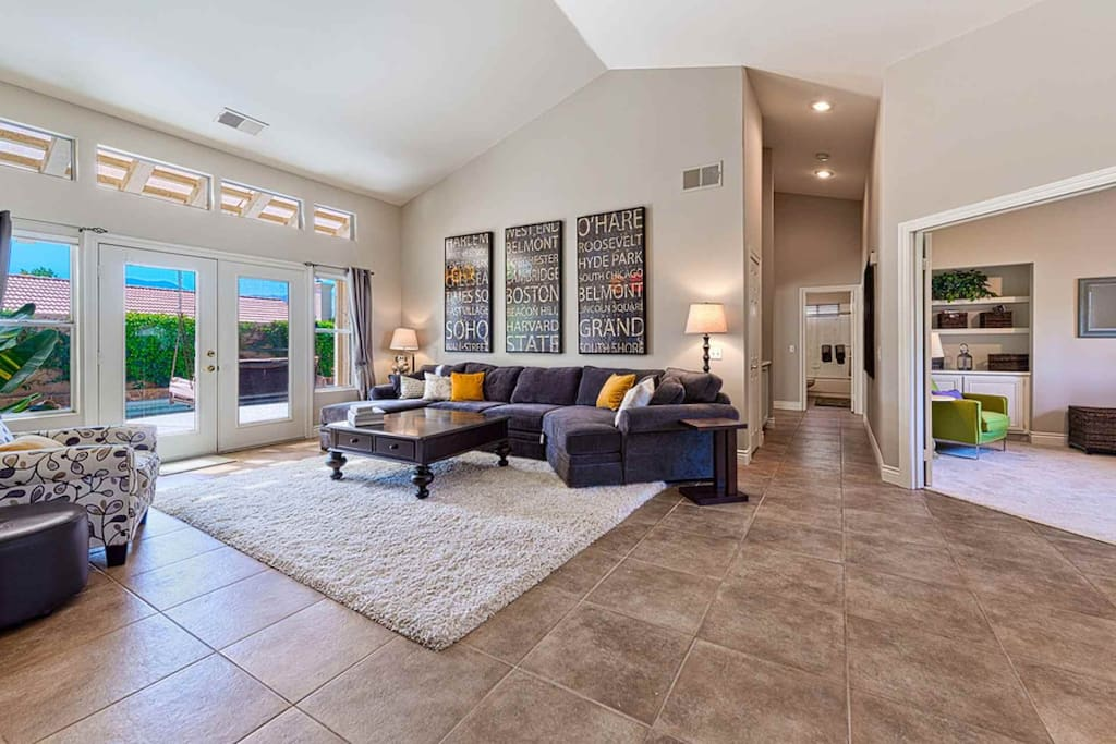 Living Room with Large comfortable couch and view of backyard with pool
