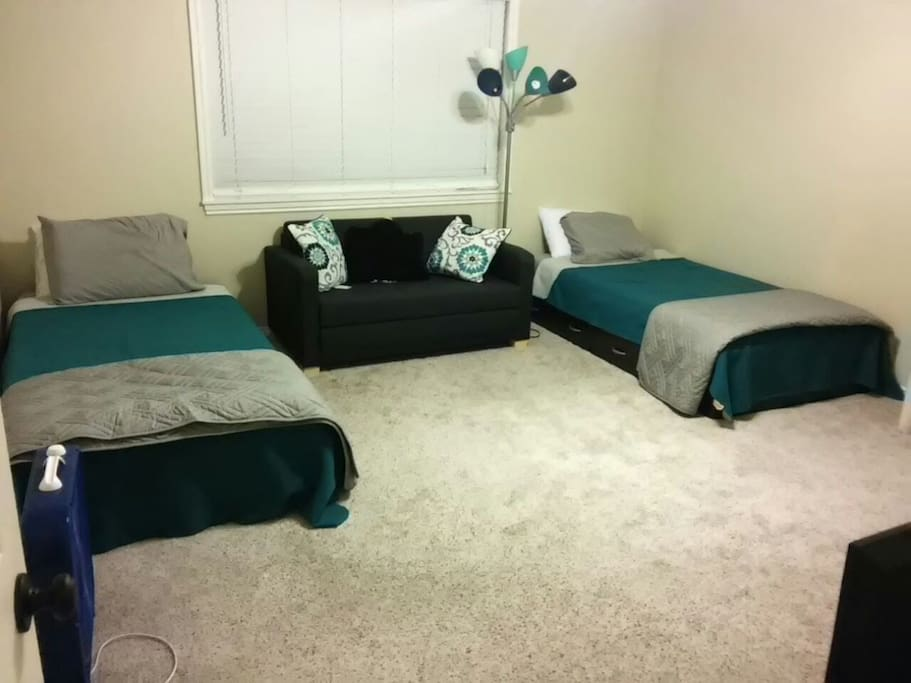 A queen air mattress fits in front of the futon, or with the futon pulled out, it fits between the beds and TV