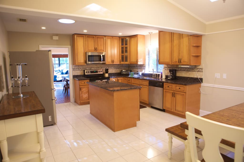 Large Fully Equipped Kitchen with Large Stainless Steel Fridge, Granite Countertops and Beautiful Cabinetry