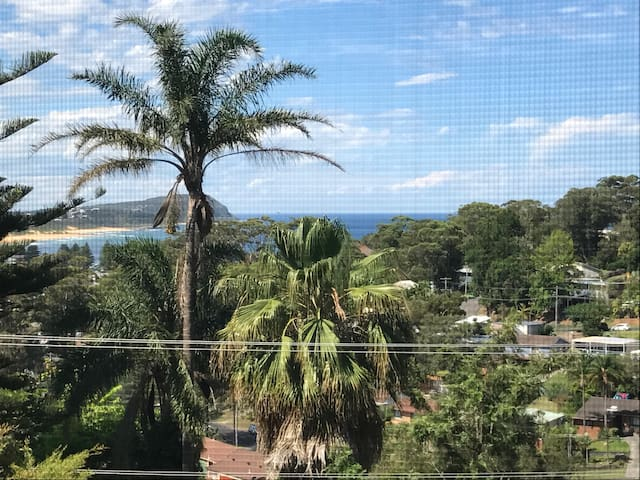 Modern studio with ocean glimpses
