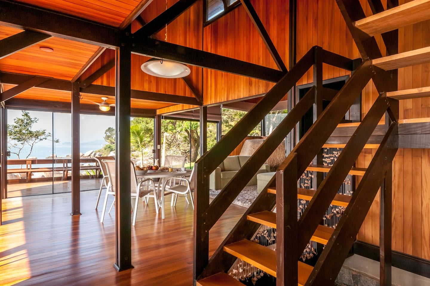 Living room of the beach house with full glass windows
