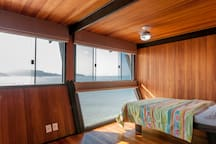 One of the bedroom of the beach house and its panoramic view
