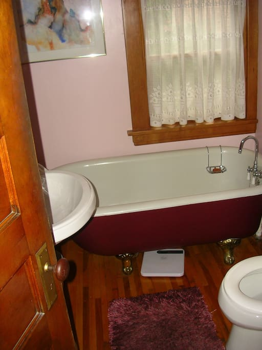 Nearby shared bathroom with clawfoot tub