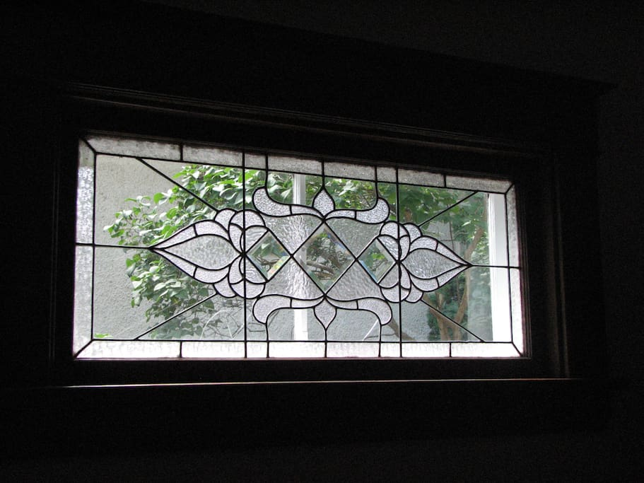 One of three leaded glass windows in the house