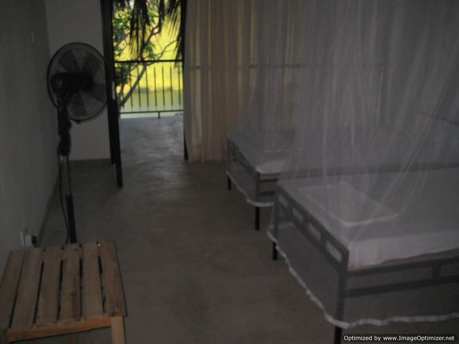 bedroom with mosquito nets