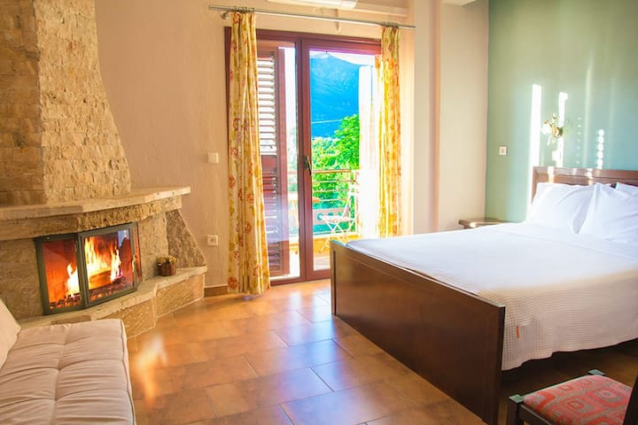 Gaia Kaimaktsalan-Room with Fireplace