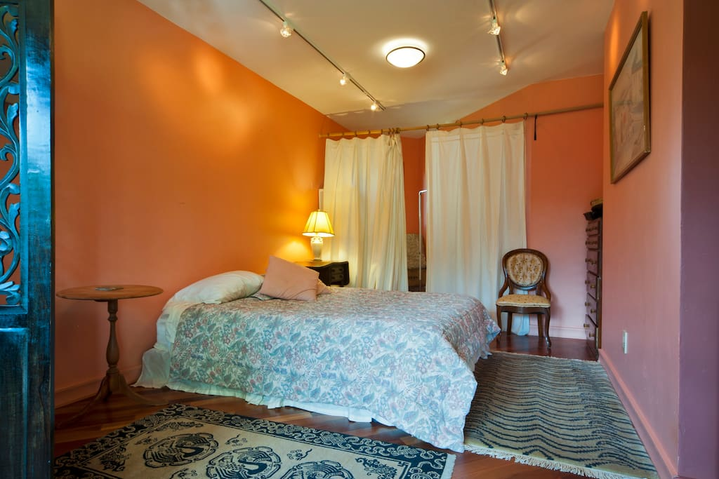 Rose room bed with curtains to walk-in closet space