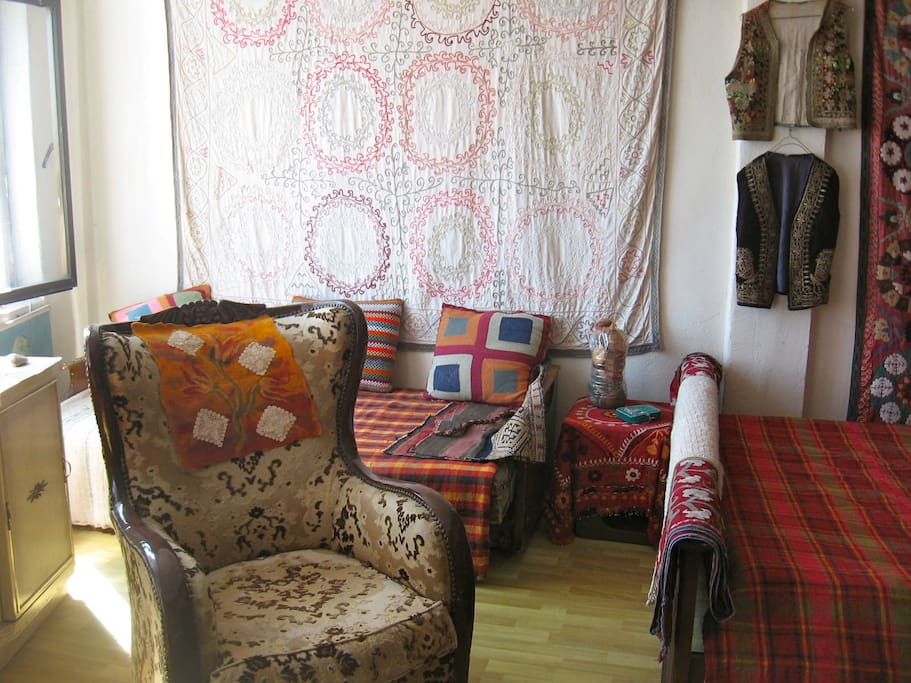 Day bed and seating area with Turkish and Central Asian textile decor