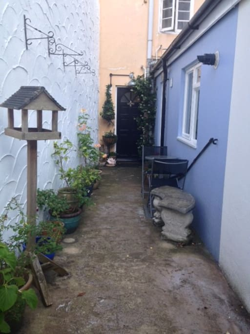 Right of way over patio path leading to entrance door of Hummingbird House.