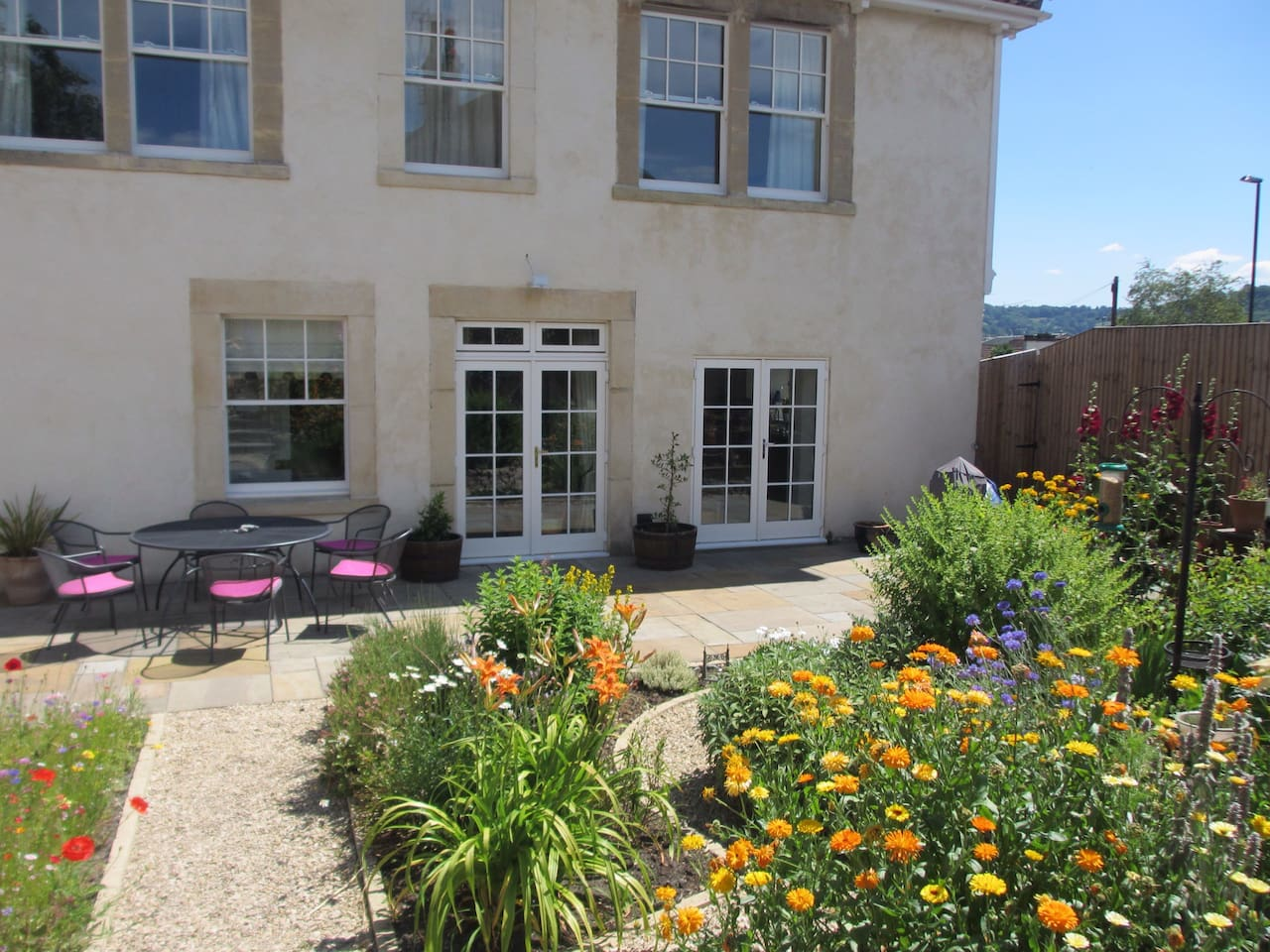 The house has a large, private garden at the back