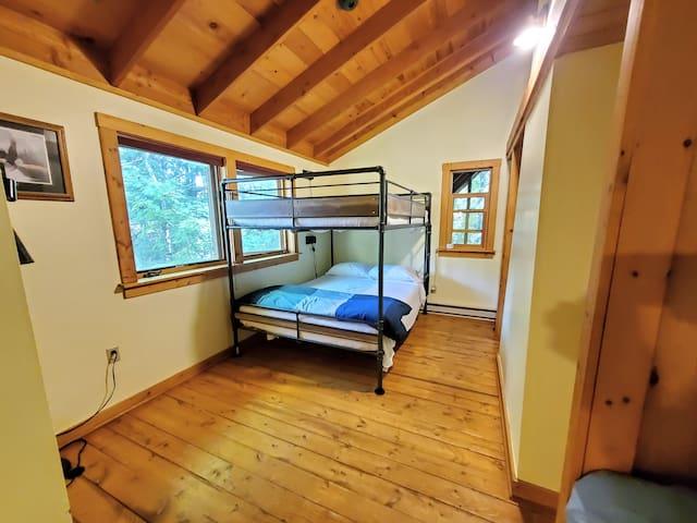 Upstairs queen over queen bunk bed