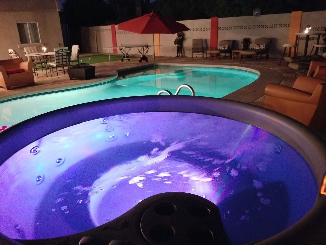 Nightime relaxing in the heated pool and new hot tub, Old Town Scottsdales only true 8 bed, 4 bath sleeps 20 easily