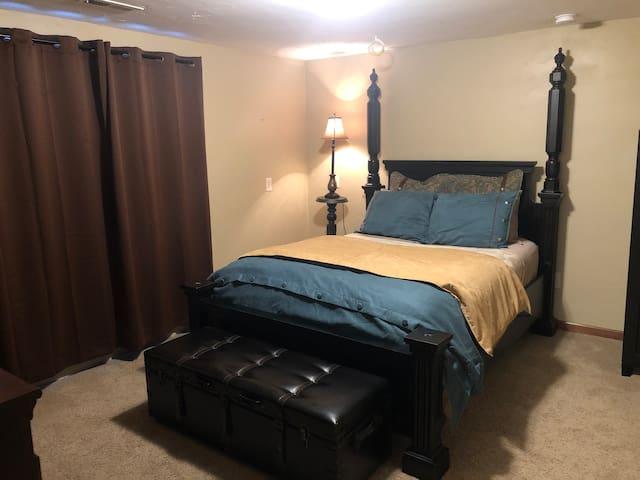Queen bedroom in basement.