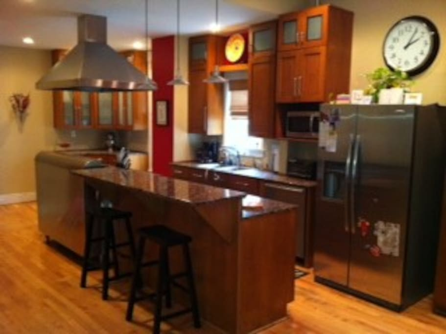 Granite counter tops, industrial Wolf range, stainless steel appliances