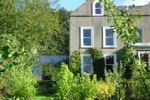 Churchfield house set in peaceful gardens