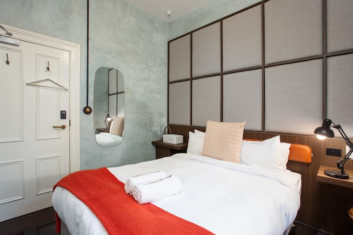 Recently Renovated Stylish Queen Hotel Room