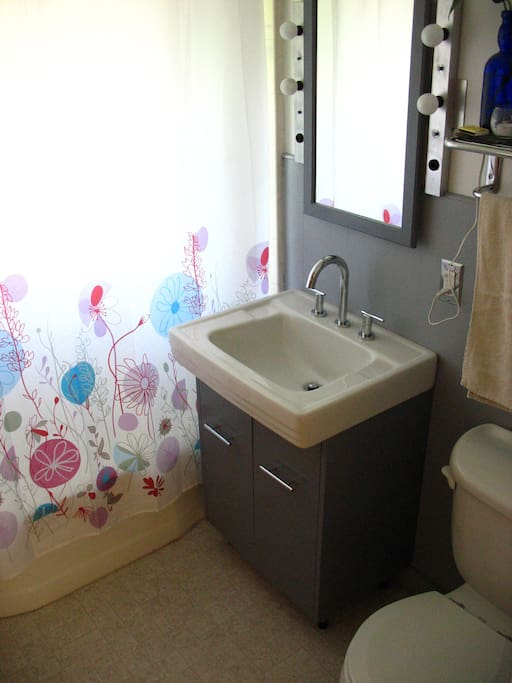 Shared bathroom, right next to your room.