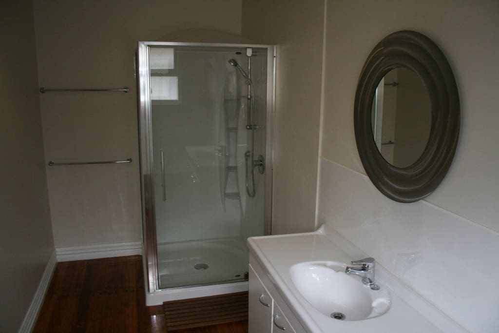 1mx1m shower with shower dome, vanity/sink, mirror in main bathroom