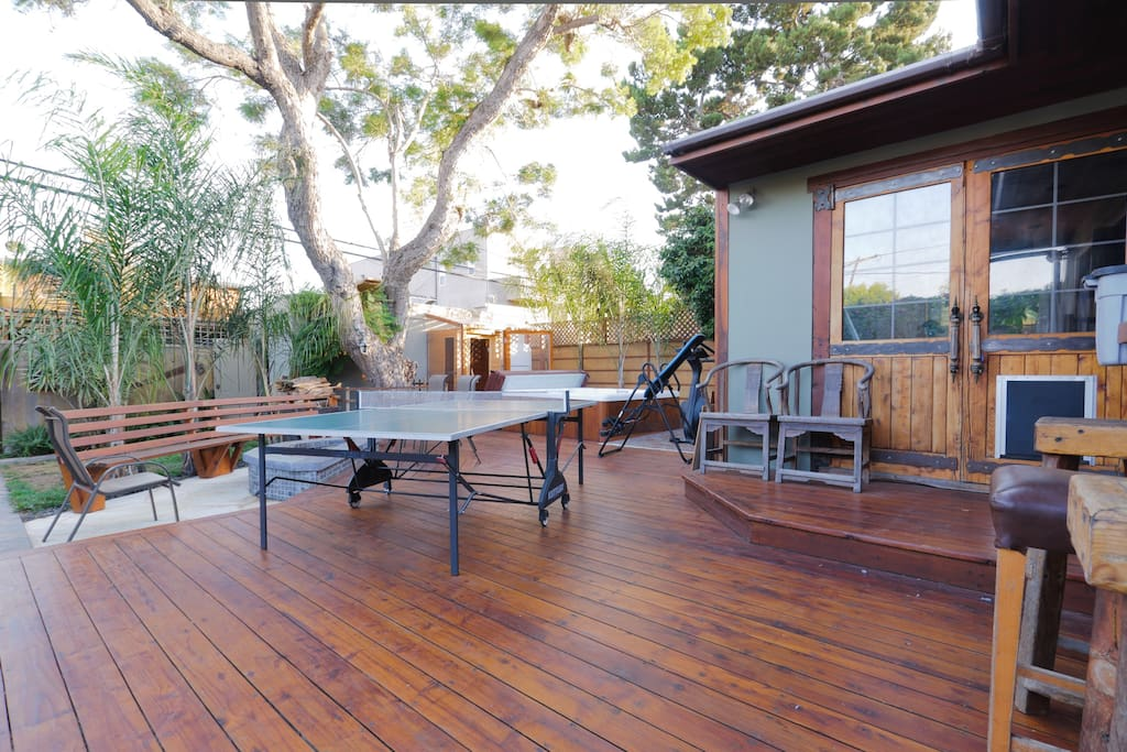 Backyard Deck, W/ Fire pit (L), Ping Pong table (C), Sauna & Spa in background