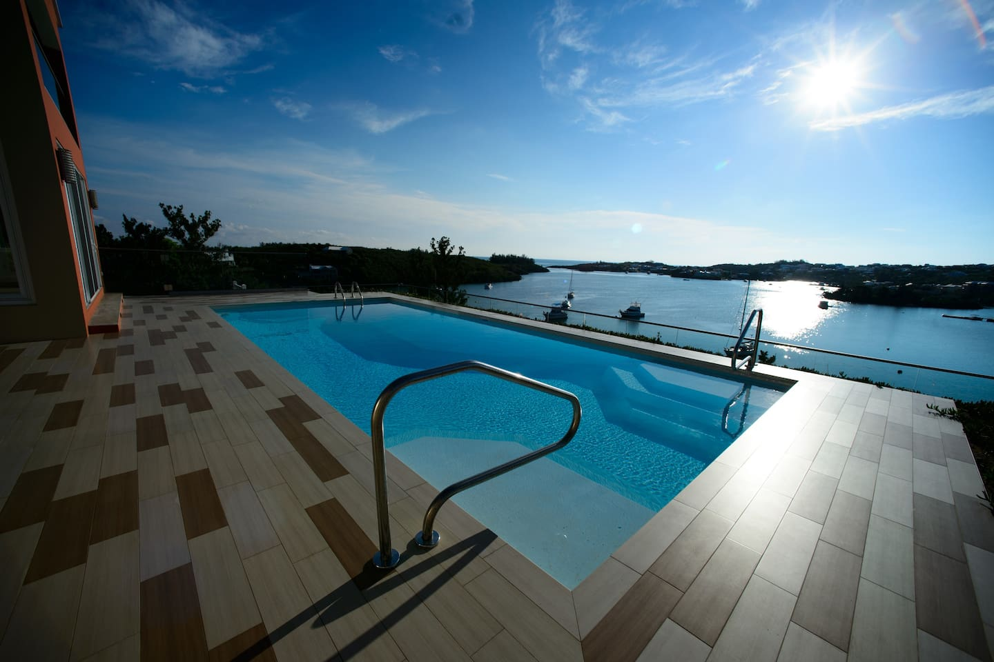 The pool deck beckons you! Relax in or outside the pool, making this a perfect start to your Bermuda vacation.