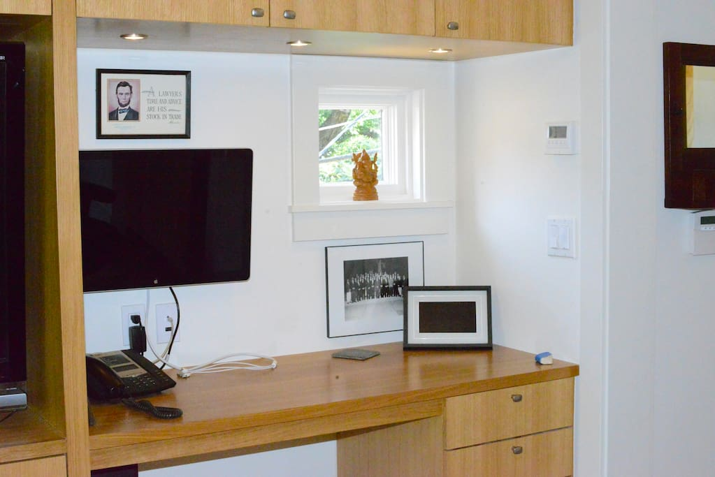 Desk where you can connect your Mac to this large Apple screen